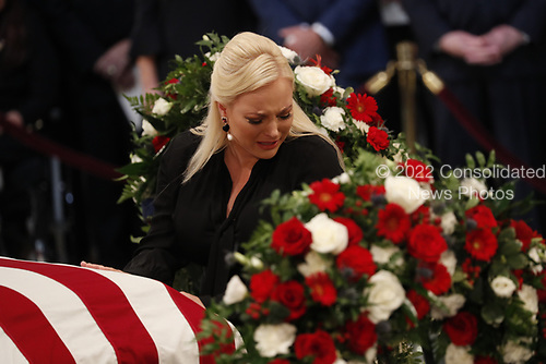 Meghan McCain, daughter of late U.S. Senator John McCain, touches her father's casket during ceremonies honoring Senator McCain inside the U.S. Capitol Rotunda in Washington, U.S., August 31, 2018. REUTERS/Kevin Lamarque