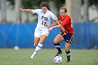 2 October 2011:  FIU defender Kelly Ann Hutchinson (12) battles South Alabama midfielder Morgan Motes (23) for the ball in the second half as the FIU Golden Panthers defeated the University of South Alabama Jaguars, 2-0, at University Park Stadium in Miami, Florida.