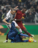 Roma's goalkeeper Wojciech Szczesny, bottom, grabs the ball, assisted by his teammate Antonio Ruediger, right, as he is challenged by Juventus' Leonardo Bonucci during the Italian Serie A football match between Juventus and Roma at Juventus Stadium.