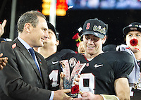 STANFORD, CA - November 30, 2012:  Sanford quarterback Kevin Hogan (8) accepting the MVP of the Stanford Cardinal vs the UCLA Bruins game at Stanford Stadium in Stanford, CA. Final score Stanford Cardinal 27, UCLA Bruins 24.