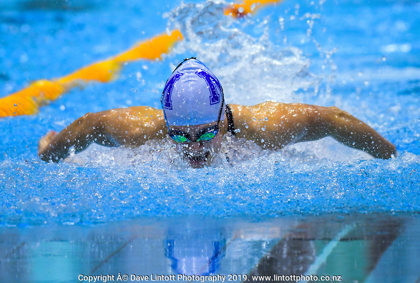 Brearna Crawford competes in the under-16 girls 50m butterfly final. Day three finals of the Swimming NZ National Age Group Championships at Wellington Regional Aquatic Centre in Wellington, New Zealand on Thursday, 18 April 2019. Photo: Dave Lintott / lintottphoto.co.nz