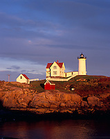 York County, ME<br /> Cape Neddick (&quot;Nubble&quot;) Light Station (1879) in evening light under clearing storm clouds