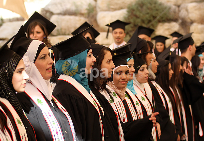 Palestinian students celebrate during their graduation ceremony at Birzeit University near the West Bank city of Ramallah on June 6, 2010. Photo by Eyad Jadallah