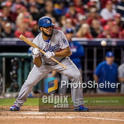 13 October 2016: Los Angeles Dodgers pitcher Kenley Jansen sets to bunt during the NLDS Game 5 against the Washington Nationals at Nationals Park in Washington, DC. The Dodgers edged out the Nationals 4-3, to take Game 5, and the Series, 3 games to 2, moving on to the National League Championship against the Chicago Cubs. Mandatory Credit: Ed Wolfstein Photo *** RAW (NEF) Image File Available ***