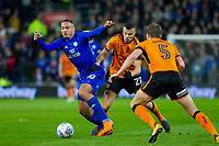 Kenneth Zohore of Cardiff City takes on Romain Saiss and Ryan Bennett of Wolverhampton Wanderers during the Sky Bet Championship match between Cardiff City and Wolverhampton Wanderers at the Cardiff City Stadium, Cardiff, Wales on 6 April 2018. Photo by Mark  Hawkins / PRiME Media Images.