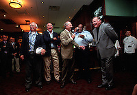 Former Green Bay Packers Fuzzy Thurston, Bob Skoronski, Bart Starr, Willie Davis and Jerry Kramer are all enjoying themselves during the auction portion of the Lombardi's Legends Reunion at Lombardi's Steakhouse in Appleton, Wisconsin in September of 2001.