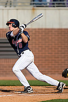 John Hicks #8 of the Virginia Cavaliers follows through on his swing versus the East Carolina Pirates at Clark-LeClair Stadium on February 20, 2010 in Greenville, North Carolina.   Photo by Brian Westerholt / Four Seam Images