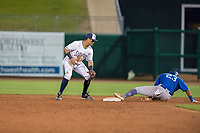 Tulsa Drillers infielder Christian Santana (23) safely slides into second ahead of the throw to Northwest Arkansas Naturals infielder Gabriel Cancel (18) on May 13, 2019, at Arvest Ballpark in Springdale, Arkansas. (Jason Ivester/Four Seam Images)