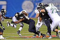 20 December 2011:  FIU defensive lineman James Jones (94) tackles Marshall running back Travon Van (7) in the first quarter as the Marshall University Thundering Herd defeated the FIU Golden Panthers, 20-10, to win the Beef 'O'Brady's St. Petersburg Bowl at Tropicana Field in St. Petersburg, Florida.