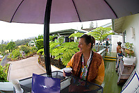A woman relaxing with her drink at Alii Kula Lavender farm at the base of Haleakala, Kula