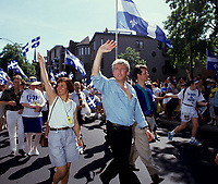 Montreal (Qc) CANADA - File Photo - circa 1992-<br /> <br /> Gilles Duceppe, deputy , the Bloc Quebecois and his wife (L),<br /> take part in the Saint-Jean Baptiste parade, June 24<br /> <br /> photo (c)  Images Distribution