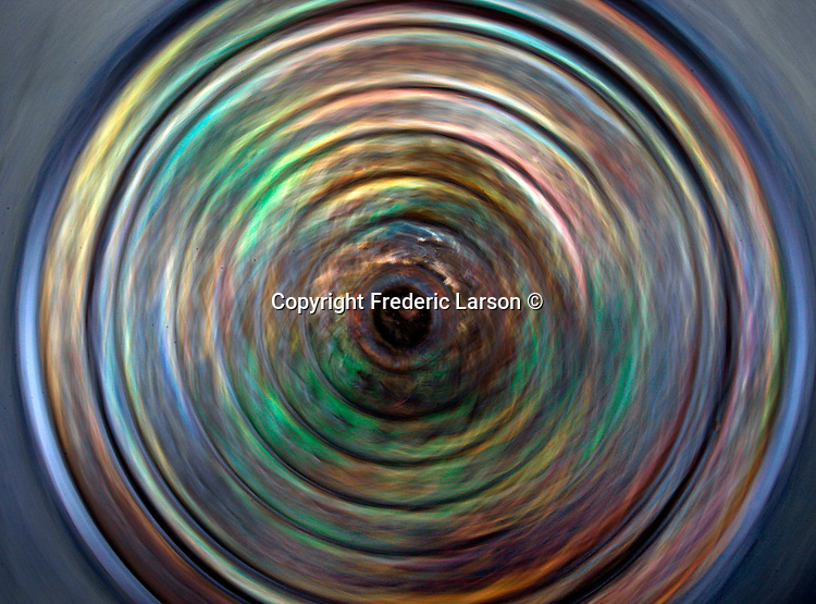 Artist view over a manhole cover taken with a slow shutter speed in San Francisco, California.