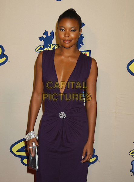 GABRIELLE UNION.Spike TV Video Game Awards 2004 held at the Barker Hangar. .December 14th, 2004.Photo Credit: Laura Farr/AdMedia.half length, plunging neckline cleavage purple brooch clasp.www.capitalpictures.com.sales@capitalpictures.com.© Capital Pictures.