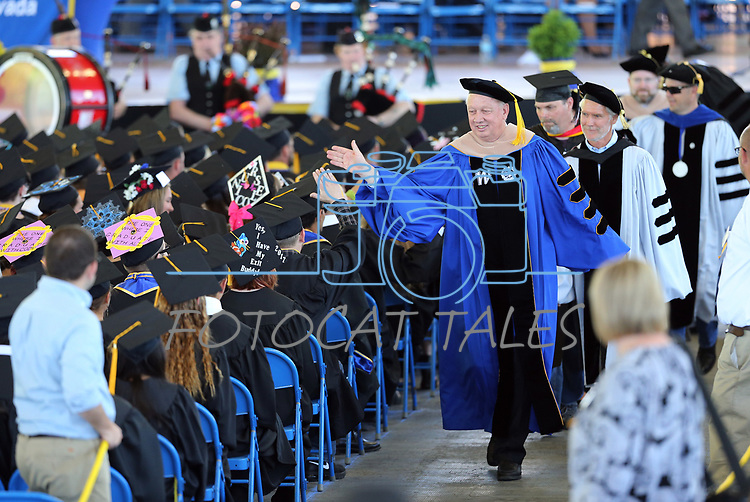 President Chet Burton high-fives with graduates following the Western Nevada College 2017 Commencement in Carson City, Nev. on Monday, May 22, 2017.  <br />