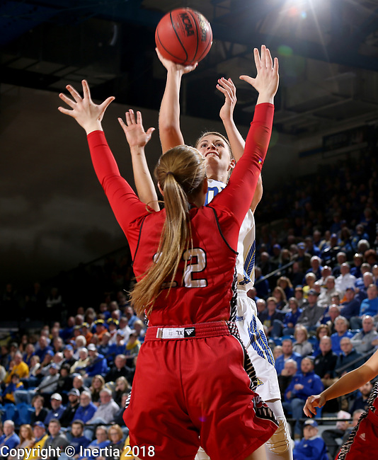 BROOKINGS, SD - JANUARY 25: Macy Miller #12 from South Dakota State University shoots over Chloe Lamb #22 from the University of South Dakota during their game Thursday night at Frost Arena in Brookings. (Photo by Dave Eggen/Inertia)