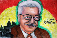 A mural of interim Palestinian leader and presidential candidate Mahmoud Abbas is seen in Gaza city, on the front of a Fatah building, Friday Dec. 10, 2004.Photo by Quique Kierszenbaum