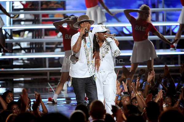 LOS ANGELES, CA - JUNE 29 : (L-R) Pharrell Williams and Missy Elliott perform onstage at the BET Awards '14 at Nokia Theatre L.A. Live on June 29, 2014 in Los Angeles, California. Credit: PGMicelotta/MediaPunch