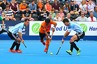 Tengku Tajuddin of Malaysia skips through two Argentine defenders during the Hockey World League Semi-Final match between Argentina and Malaysia at the Olympic Park, London, England on 24 June 2017. Photo by Steve McCarthy.