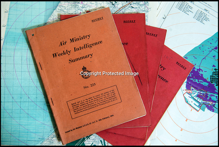 BNPS.co.uk(01202 558833)<br /> Pic: C&TAuctions/BNPS<br /> <br /> Top Secret - Air Ministry Weekly Intelligence Summary leading up to and beyond the invasion.'<br /> <br /> Found in a french flea market - a Top Secret 'how to' guide to D-Day.<br /> <br /> Fascinating top secret documents and photos of the extensive planning that went into the Normandy invasion have emerged after 72 years.<br /> <br /> Incredibly detailed plans of Nazi defences, high resolution photographs, weekly intel reports and even analysis of the German weapons they were likely to face are included in the sale.<br /> <br /> One photo taken at zero feet shows German troops scattering across a beach as a low-level RAF aircraft sweeps by to capture the plethora of anti-landing obstacles.<br /> <br /> Other images show the famous coastline with key cliff-top targets that had to be destroyed either before or on D-Day itself.<br /> <br /> The archive is being sold by C&T Auctions of Kent.