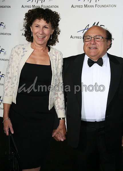 9 September 2006 - Beverly Hills, California. Rhea Perlman and Danny DeVitto. 3rd Annual Alfred Mann Foundation Innovation and Inspiration Gala Honoring Richard and Nancy Riordan. Photo Credit: Byron Purvis/AdMedia