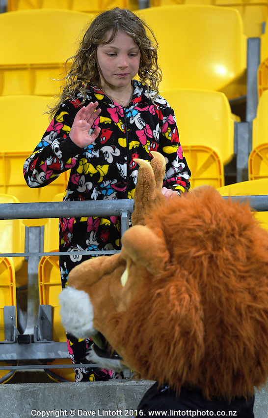 Leo the Lion high-fives a fan during the Mitre 10 Cup rugby union match between Wellington Lions and North Harbour at Westpac Stadium, Wellington, New Zealand on Saturday, 3 September 2016. Photo: Dave Lintott / lintottphoto.co.nz