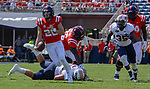 Shea Patterson dodges UT Martin's defense during the game on Sat., Sept. 9, 2017. Ole Miss wins 45-23. Photo by Marlee Crawford/Ole Miss Communications