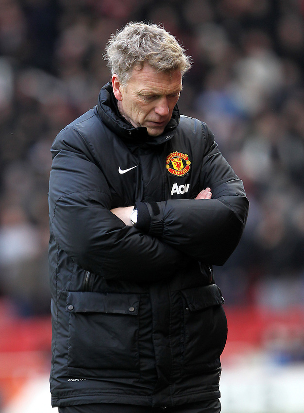 Manchester United's Manager David Moyes  looks worried<br /><br />Photo by Mick Walker/CameraSport<br /><br />Football - Barclays Premiership - Stoke City v Manchester United - Saturday 1st February 2014 - Britannia Stadium - Stoke<br /><br />&copy; CameraSport - 43 Linden Ave. Countesthorpe. Leicester. England. LE8 5PG - Tel: +44 (0) 116 277 4147 - admin@camerasport.com - www.camerasport.com
