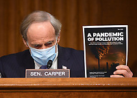 "United States Senator Tom Carper (Democrat of Delaware), ranking member, US Senate Environment and Public Works Committee, holds up a magazine as he delivers opening remarks at a hearing titled ""Oversight of the Environmental Protection Agency"" in the Dirksen Senate Office Building on May 20, 2020 in Washington, DC. Andrew Wheeler, Administrator, United States Environmental Protection Agency (EPA) will be asked about the rollback of regulations by the Environment Protection Agency since the pandemic started in March.       <br /> Credit: Kevin Dietsch / Pool via CNP/AdMedia"