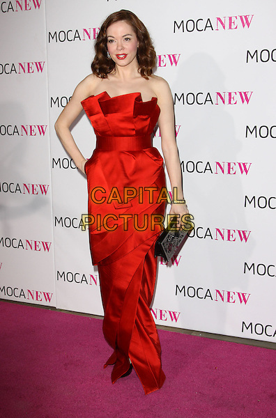 ROSE McGOWAN .At MOCA's 30th Anniversary Gala held at MOCA, Los Angeles, California, USA, 14th November 2009. .full length strapless red dress long maxi folded  hand on hip origami pleated black clutch bag .CAP/ADM/KB.©Kevan Brooks/AdMedia/Capital Pictures.