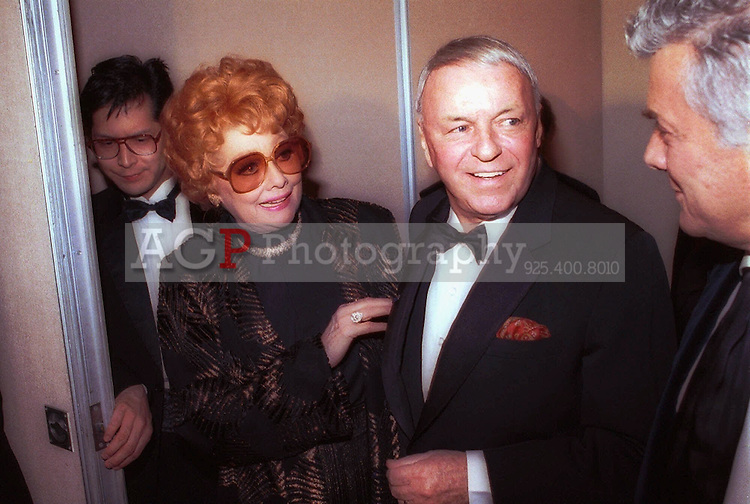 Jan 26, 1989 - Beverly Hills, California, USA - Lucille Ball and Frank Sinatra get together prior to Sinatra receiving the Will Rogers Award presented by the Beverly Hills Chamber of Commerce Jan. 26, 1989 during a star-studded gala in  Beverly Hills. Sinatra was given the award for his outstanding contributions to the world of entertainment. Ball is a past receipient of the award..(Credit Image: © Alan Greth)