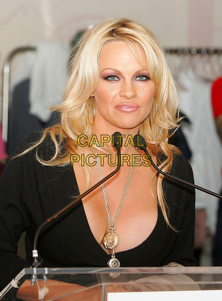 PAMELA ANDERSON.At the an event hosted by PETA (People for the Ethical Treatment of Animals) to honor people who have made outstanding contributions in promoting PETA campaigns that take a stand against cruelty to animals,.New York, NY, USA, 03 February 2006..half length speaking black top gold necklace cleavage.Ref: ADM/JL.www.capitalpictures.com.sales@capitalpictures.com.© Capital Pictures.