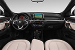 Stock photo of straight dashboard view of 2016 BMW X1 xLine 5 Door Suv Dashboard