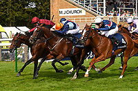 Winner of The Tattersalls Sovereign Stakes, Kick On (red) ridden by Oisin Murphy and trained by John Gosden during Horse Racing at Salisbury Racecourse on 15th August 2019