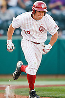 Ricky Eisenberg (10) running to first after hitting during the NCAA matchup between the University of Arkansas-Little Rock Trojans and the University of Oklahoma Sooners at L. Dale Mitchell Park in Norman, Oklahoma; March 11th, 2011.  Oklahoma won 11-3.  Photo by William Purnell/Four Seam Images