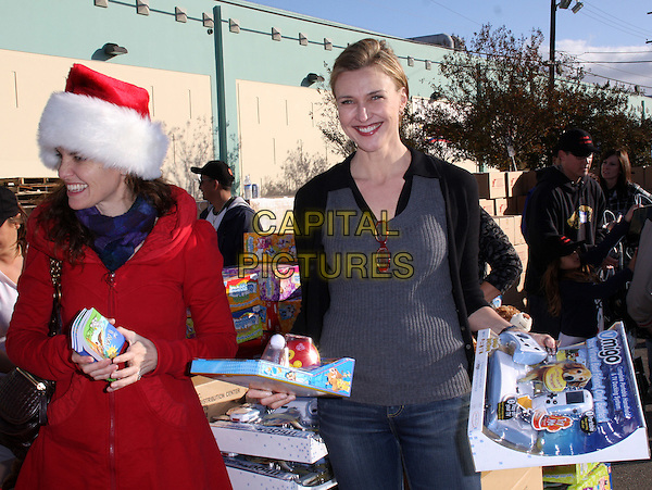 "AMY BRENNEMAN & BRENDA STRONG .""The Salvation Army"" Making Miracle on South Central, Sponsored by Feed The Children and NBPA held at Salvation Army Headquarters,  Los Angeles, CA, USA,  13 December 2008..half  length red santa hat xmas christmas  grey gray top glasses.CAP/ADM/KB.©Kevan Brooks/Admedia/Capital PIctures"