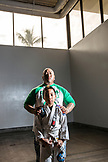 USA, Oahu, Hawaii, portrait of Justice a young Jujitsu Martial Arts fighter with his father before the start of the ICON grappling tournament in Honolulu