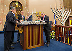 L-R, Nassau County Executive ED MANGANO, New York Senator-Elect MICHAEL VENDITTO, Assemblyman DAVE McDONOUGH, Assistant Rabbi RAVID TILLES, and others, participate in the ceremonial candle lighting on the bema in the main sanctuary of the Merrick Jewish Centre, when it attempts to regain the Guinness World's Record for Most Menorot Lit in One Place at One Time that the congregation held in 2011. On the third night of Hanukkah, the 'Light Up the Night 2 - Bringing the Record Home' event also included bagpipers.