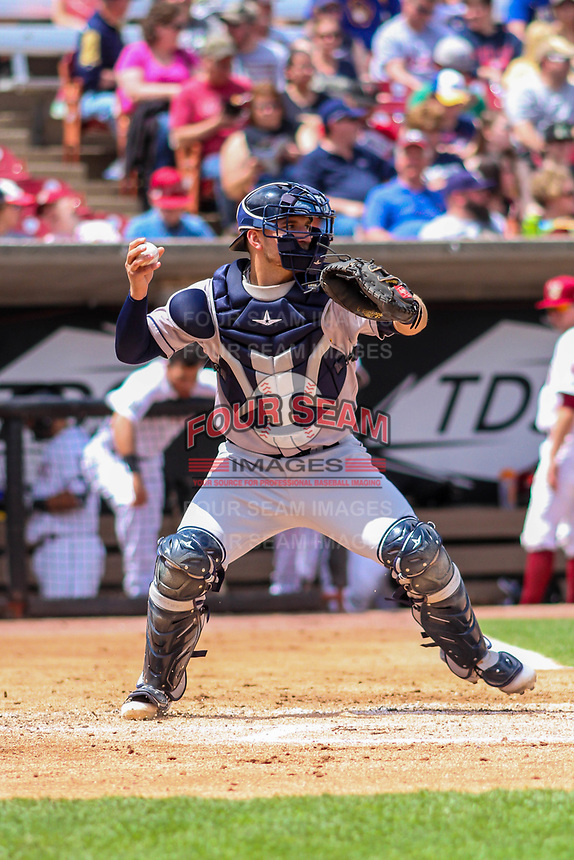 Burlington Bees catcher Harrison Wenson (12) throws down to second base between innings during a Midwest League game against the Wisconsin Timber Rattlers on May 19, 2018 at Fox Cities Stadium in Appleton, Wisconsin. Wisconsin defeated Burlington 1-0. (Brad Krause/Four Seam Images)