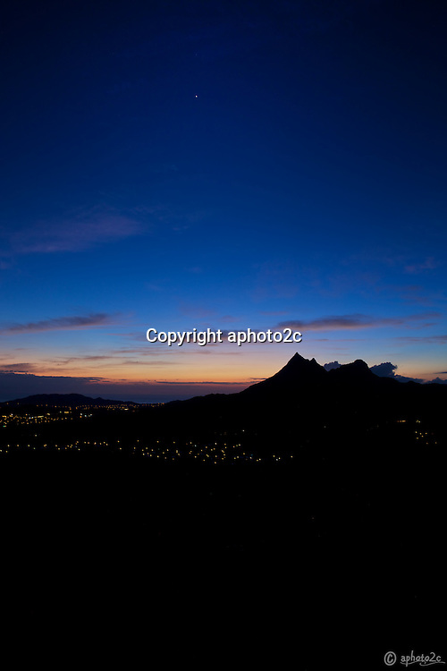 On the way to photograph Luakaha Falls I stopped at the town bound lower Pali lookout to get the sun getting ready to illuminate sleepy Kailua Town.