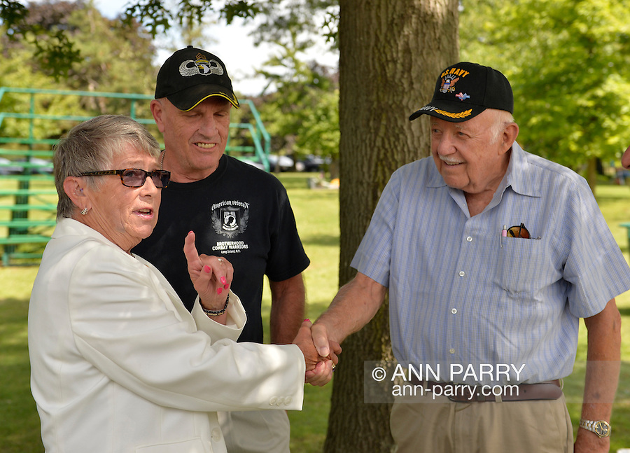 East Meadow, New York, U.S. - September 3, 2014 - Representative CAROLYN MCCARTHY (NY-04) speaks with PAT YNGSTROM (in black shirt) of Merrick, U.S. Army Paratrooper, Vietnam War Veteran, and PAUL ZYDOR, (in blue shirt) of Merrick, U.S. Navy, Korean War Veteran, before start of press conference when congressional candidate K. Rice releases a whitepaper on veterans policy and announces formation of her campaign's Veterans Advisory Committee, at Veterans Memorial at Eisenhower Park, after Rice and the outgoing Congresswoman toured Northport VA Medical Center.