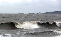 WEATHER PICTURE SWANSEA<br /> Pictured: Huge waves at Swansea Bay, overlooking Mumbles, south Wales. Monday 03 February 2014<br /> Re: High tides combined with strong winds are affecting parts of the UK.