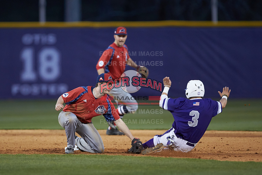 Tim Mansfield (3) of the High Point Panthers is tagged out by Tom Brady (23) of the NJIT Highlanders at Williard Stadium on February 18, 2017 in High Point, North Carolina. The Highlanders defeated the Panthers 4-2 in game two of a double-header. (Brian Westerholt/Four Seam Images)