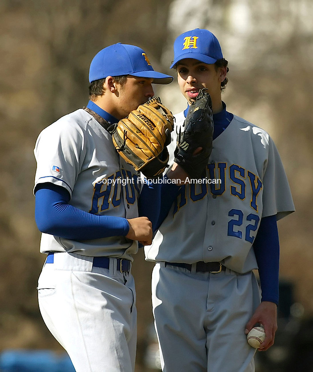 WINSTED, CT 4/9/07- 040907BZ09- Housatonic's Kyle Robinson (4) talks to pitcher Bob Chatfield (22) during  Monday's game against Gilbert.<br /> Jamison C. Bazinet Republican-American