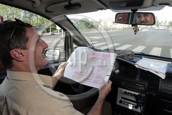 TOULOUSE - FRANCE - 27 MAY 2005-- The French referendum on the EU-Constitution.-- Taxi driver Michel DURAND has been studying the EU-Constitution while driving his taxi. -- PHOTO: JUHA ROININEN / EUP-IMAGES