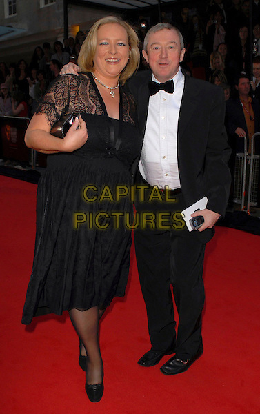 LUIS WALSH & GUEST.Arrivals at the British Academy Television Awards, (BAFTA's) held at Grosvenor House Hotel, London, UK..May 7th 2006.Ref: CAN.bafta baftas full length black dress tuxedo Louis.www.capitalpictures.com.sales@capitalpictures.com.©Capital Pictures