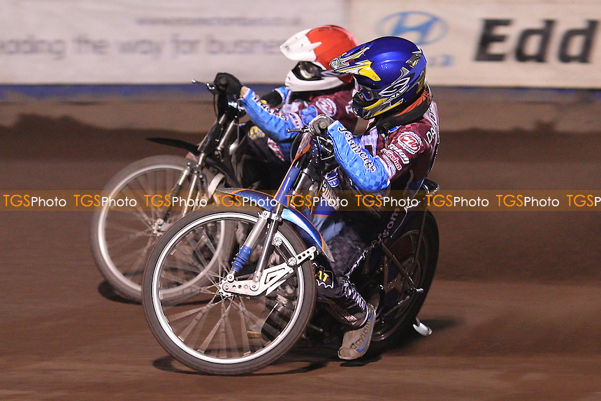 Heat 8: Daniel Davidsson (blue) and Stuart Robson (red) - Lakeside Hammers vs Coventry Bees, Elite League Speedway at the Arena Essex Raceway, Purfleet - 09/04/10 - MANDATORY CREDIT: Rob Newell/TGSPHOTO - Self billing applies where appropriate - 0845 094 6026 - contact@tgsphoto.co.uk - NO UNPAID USE.