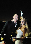 Wedding couple and midnight boat cruise to the Statue of Liberty.  Waters Edge Restaurant.Long Island City, New York.