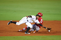 Bradenton Marauders second baseman Pablo Reyes (15) stretches for a throw as Andrew Sohn (5) slides in during a game against the Palm Beach Cardinals on August 9, 2016 at McKechnie Field in Bradenton, Florida.  Palm Beach defeated Bradenton 8-7.  (Mike Janes/Four Seam Images)