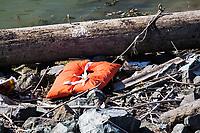 A life vest lies abandoned on the rocky shore at the San Leandro Marina on San Francisco Bay.