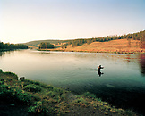 USA, Wyoming, man fishing in the Yellowstone river